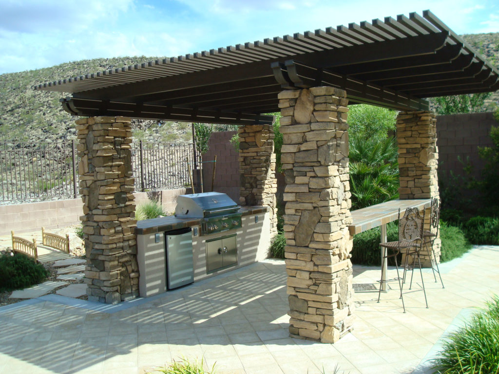 Wood Slat Patio Cover Design by  Custom Outdoor Living of Las Vegas, Nevada