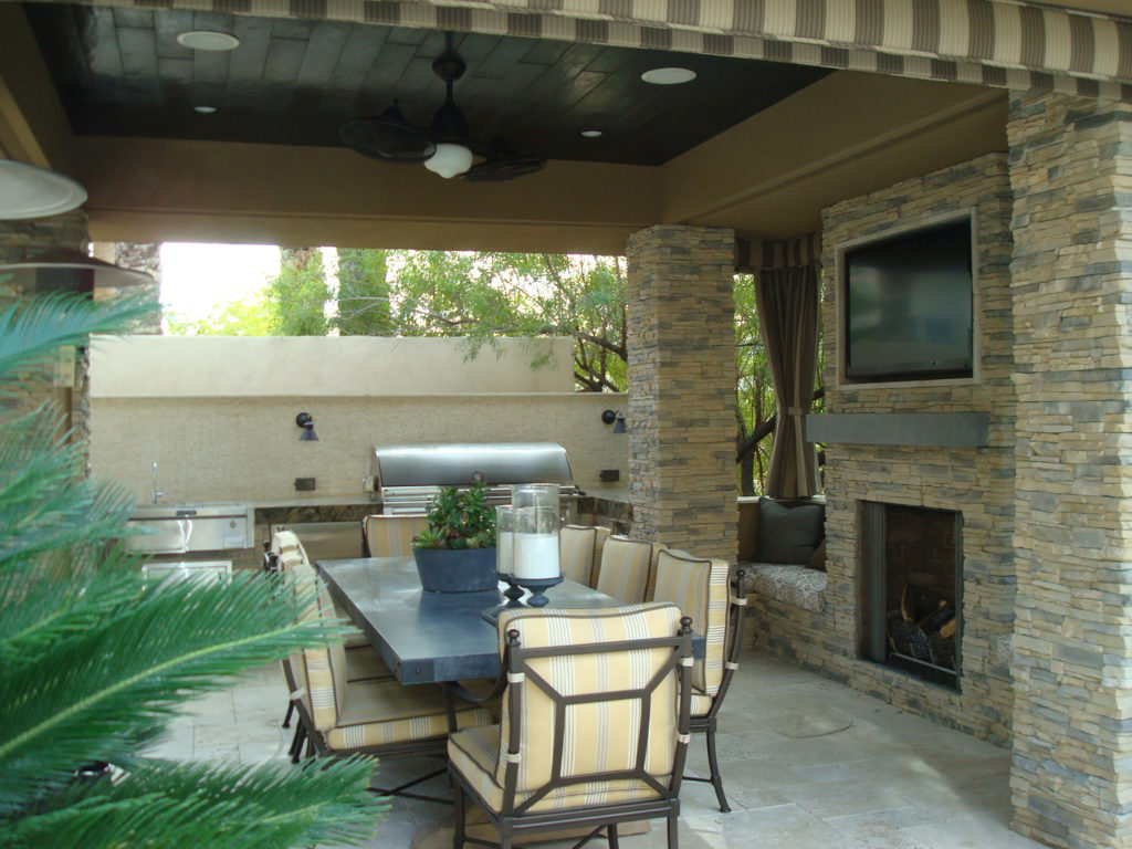 Patio Cover Design with Media Wall and Fireplace by Custom Outdoor Living