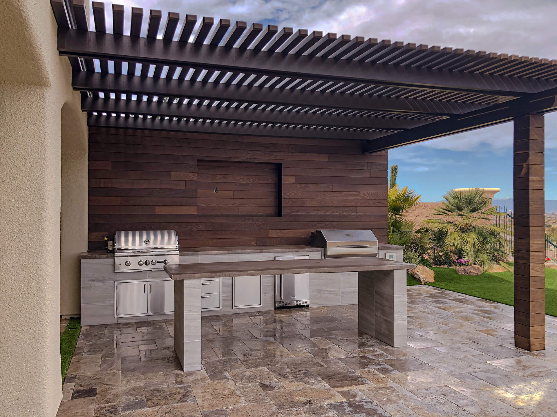Custom Outdoor Kitchen with Wood Slat Patio Cover Design