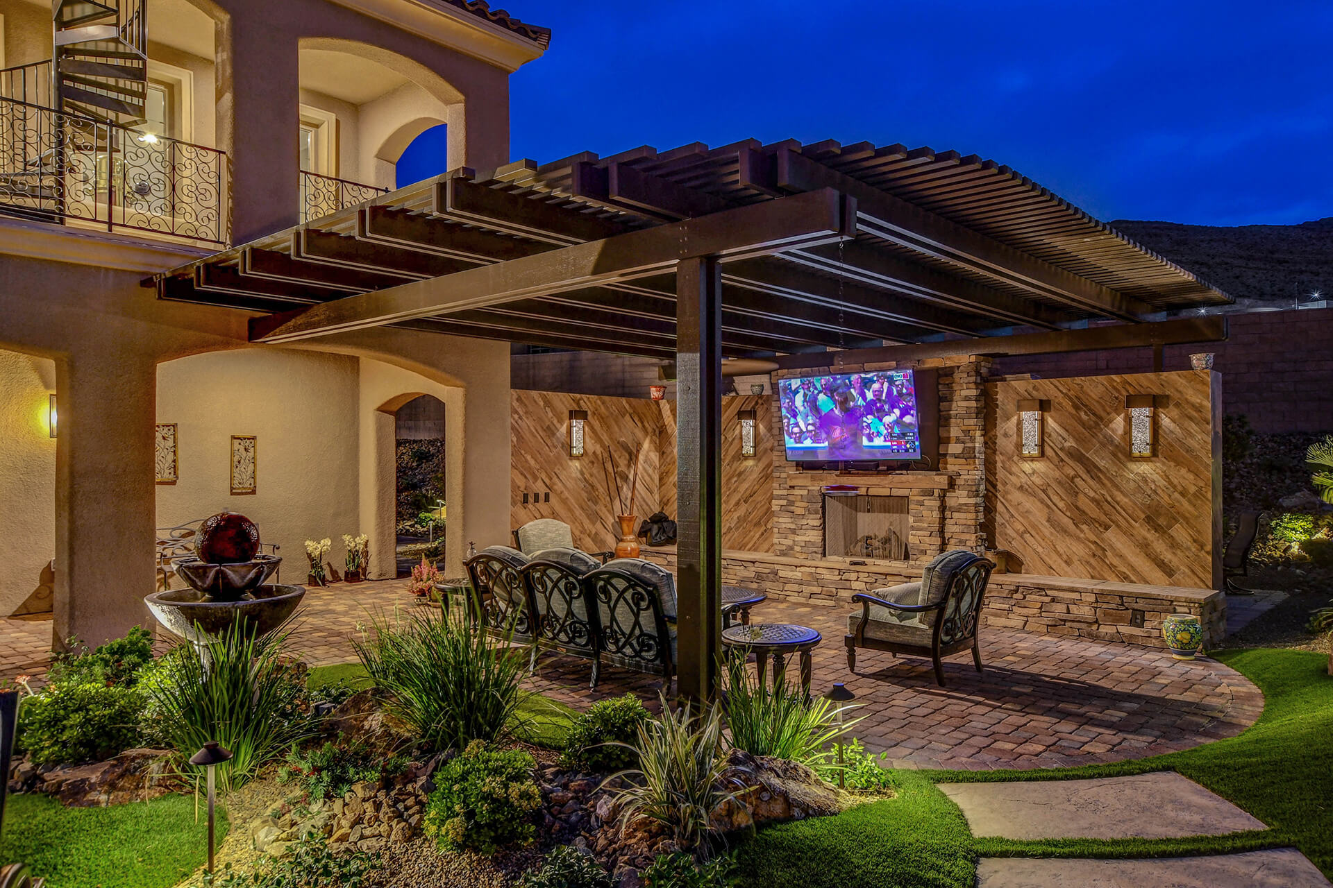 Gorgeous Soft Arch Wood Patio Cover by Custom Outdoor Living of Southern Nevada - with Media Wall